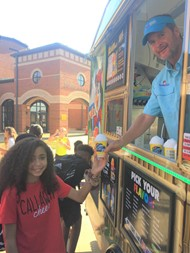 Calvin Neely shares free Kona Ice with CMS Students