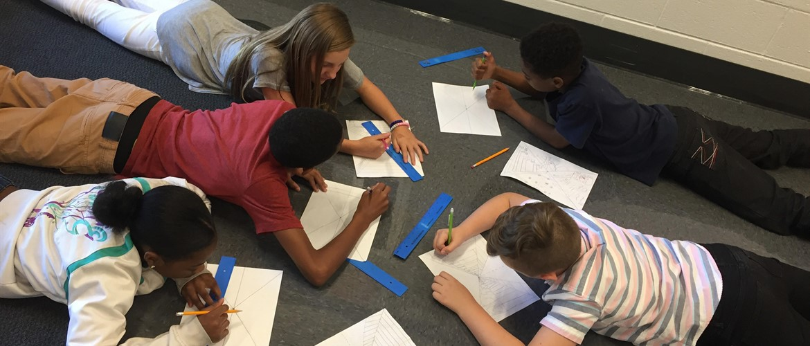Students in Ms. Kate Miller's Art class at GNMS are working together to learn the skill of one point perspective.