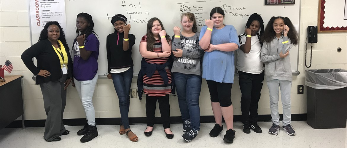 FLY Girls promoting suicide prevention by wearing yellow bands