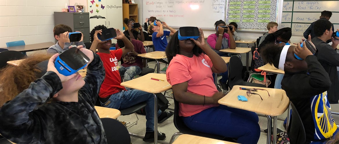 Mrs. Dowden's classes take a virtual trip using the VR goggles.