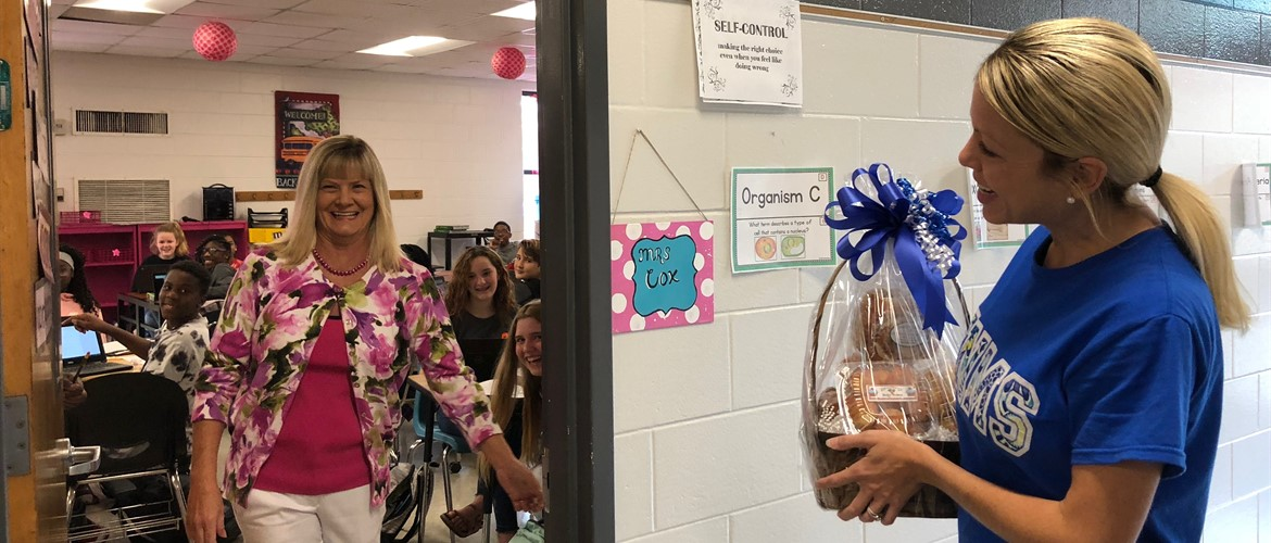 Admin Rachel Yates-Hooten surprises Teacher of the Year Debbie Cox!