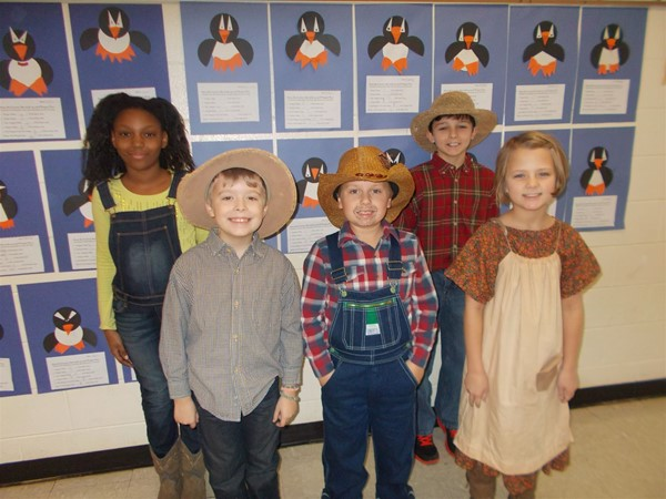 3rd grade students recently completed a unit of study on the novel Sarah, Plain and Tall.  They ended the unit by dressing up as characters from the novel, eating homemade biscuits and honey, and watching the movie adaptation of the book.