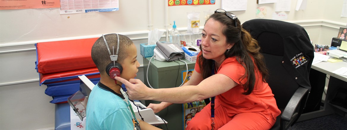 School Nurse of the Year, Amy Crites, Tests Student Hearing
