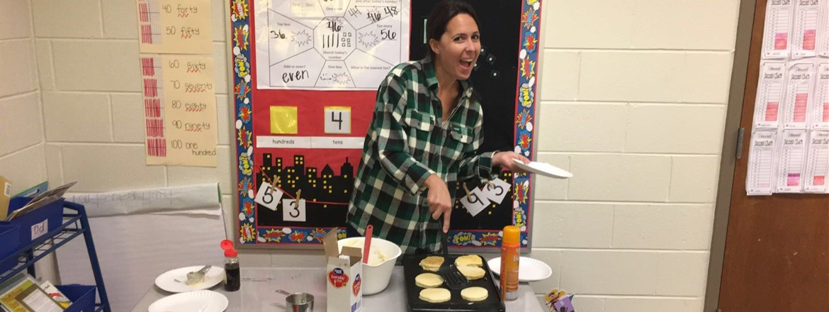 Mrs. Alford, cooking pancakes for 1st Grade Folktale Fun Day!