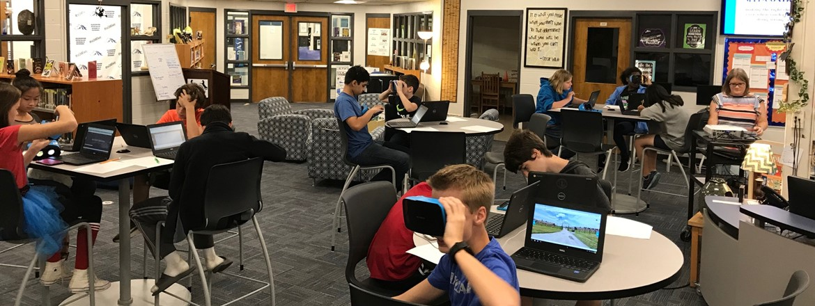 GNMS students use Virtual Reality goggles in the Media Center