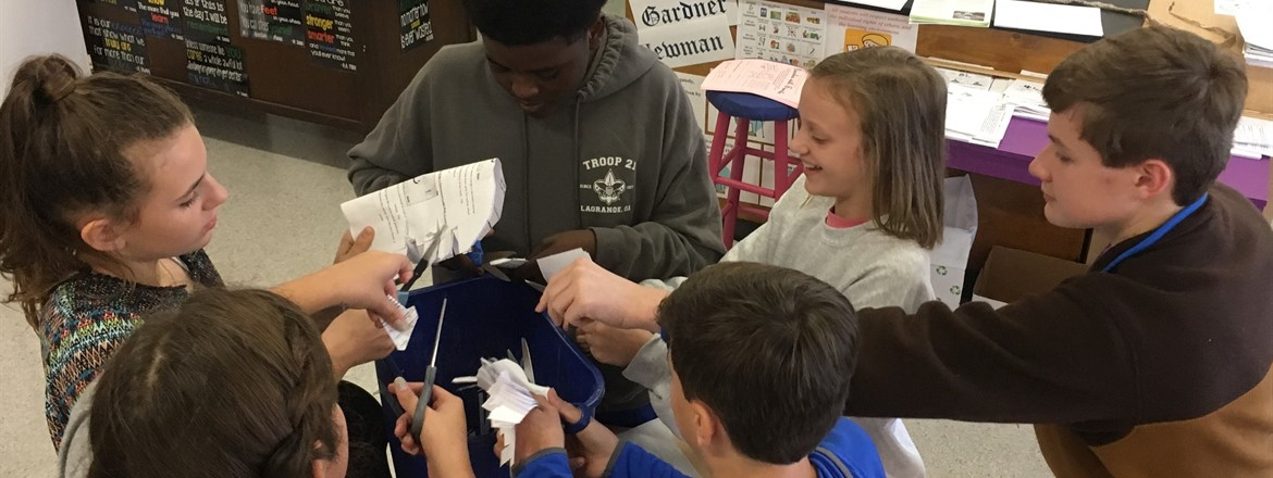 Students in Ms. Debbie Cox's Gifted Resource Class are preparing for the Lexus Eco-Challenge. They are making biomass briquettes in the biomass presser they created at Gardner Newman Middle School.
