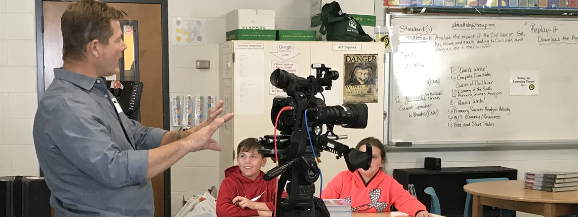 CNN Camera man gives GNMS A/V students in Ms. Abbott's class a view of real equipment used in filming.