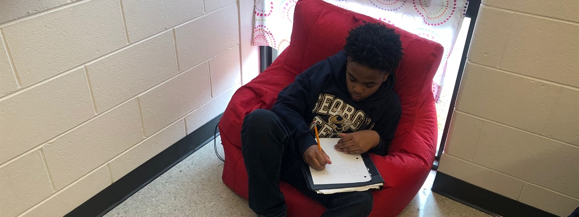 Ja'Han Brown works on a letter to students at Parkland High following the tragic shootings.
