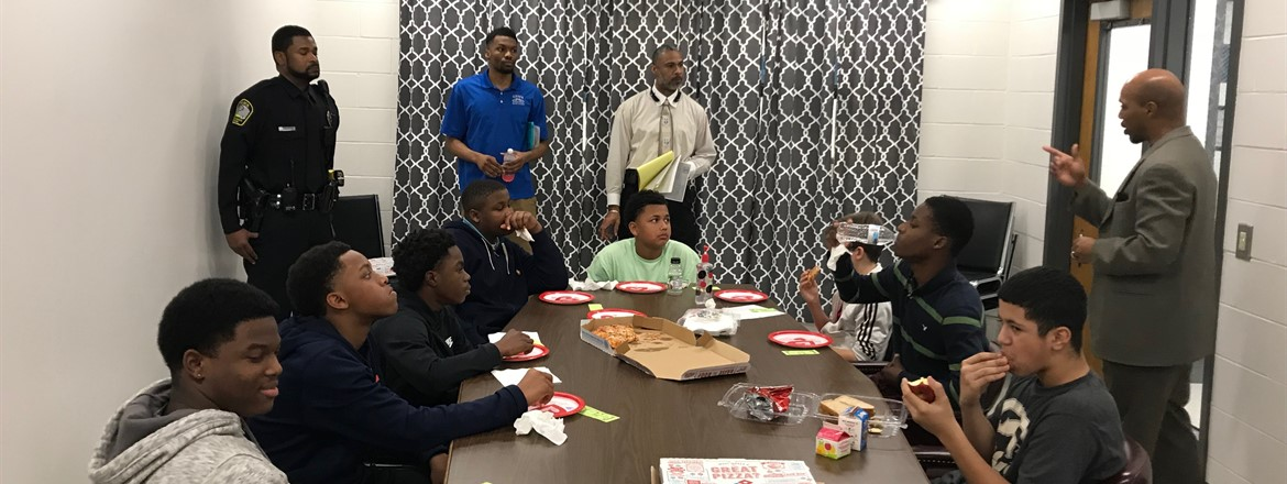 Dr. Marks, Officer Horne, Coach Manning and Dr. Travis mentor a group of  GNMS Mustangs each week over lunch.