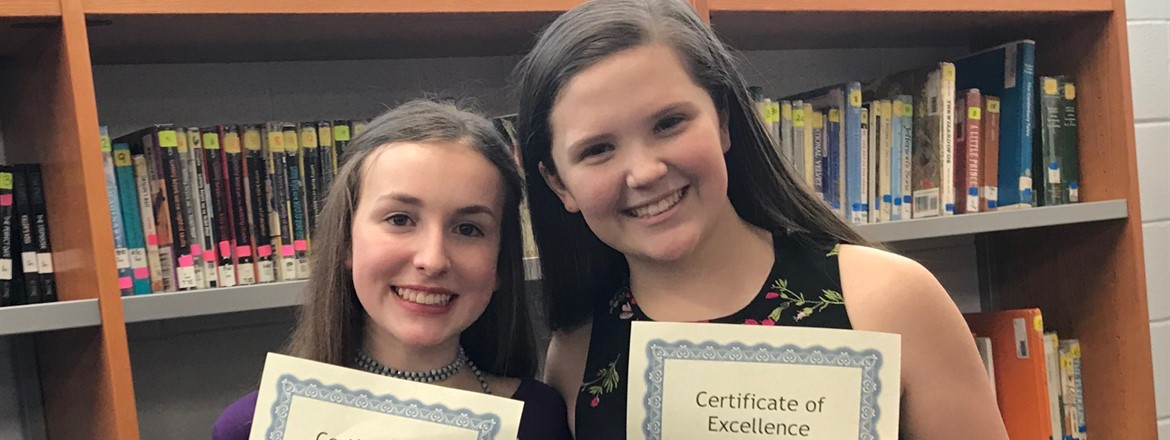 Lauren Farris, 2nd place and Ellie Moone, 1st place winners in the GNMS Girls' Optimism Oratorical Contest