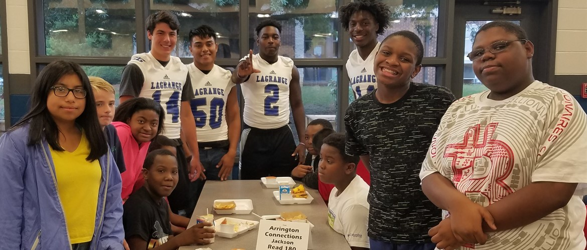 LHS football players visit GNMS